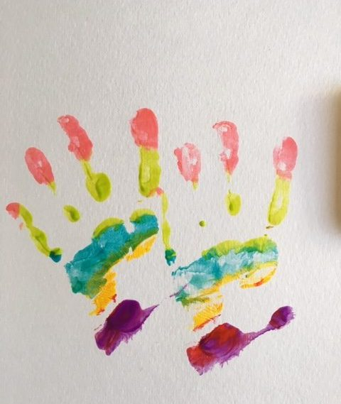 making rainbow hand prints on paper