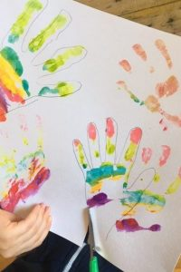 cutting out the rainbow hands