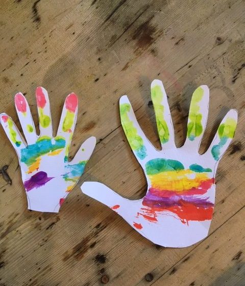 the cut out rainbow hands