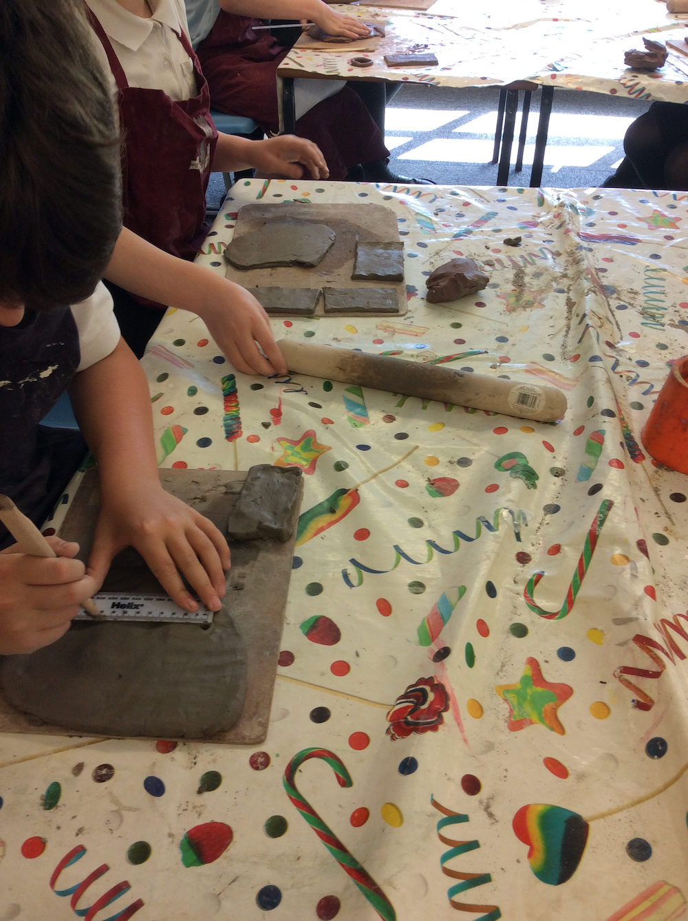 Year six pupils make memory boxes out of clay