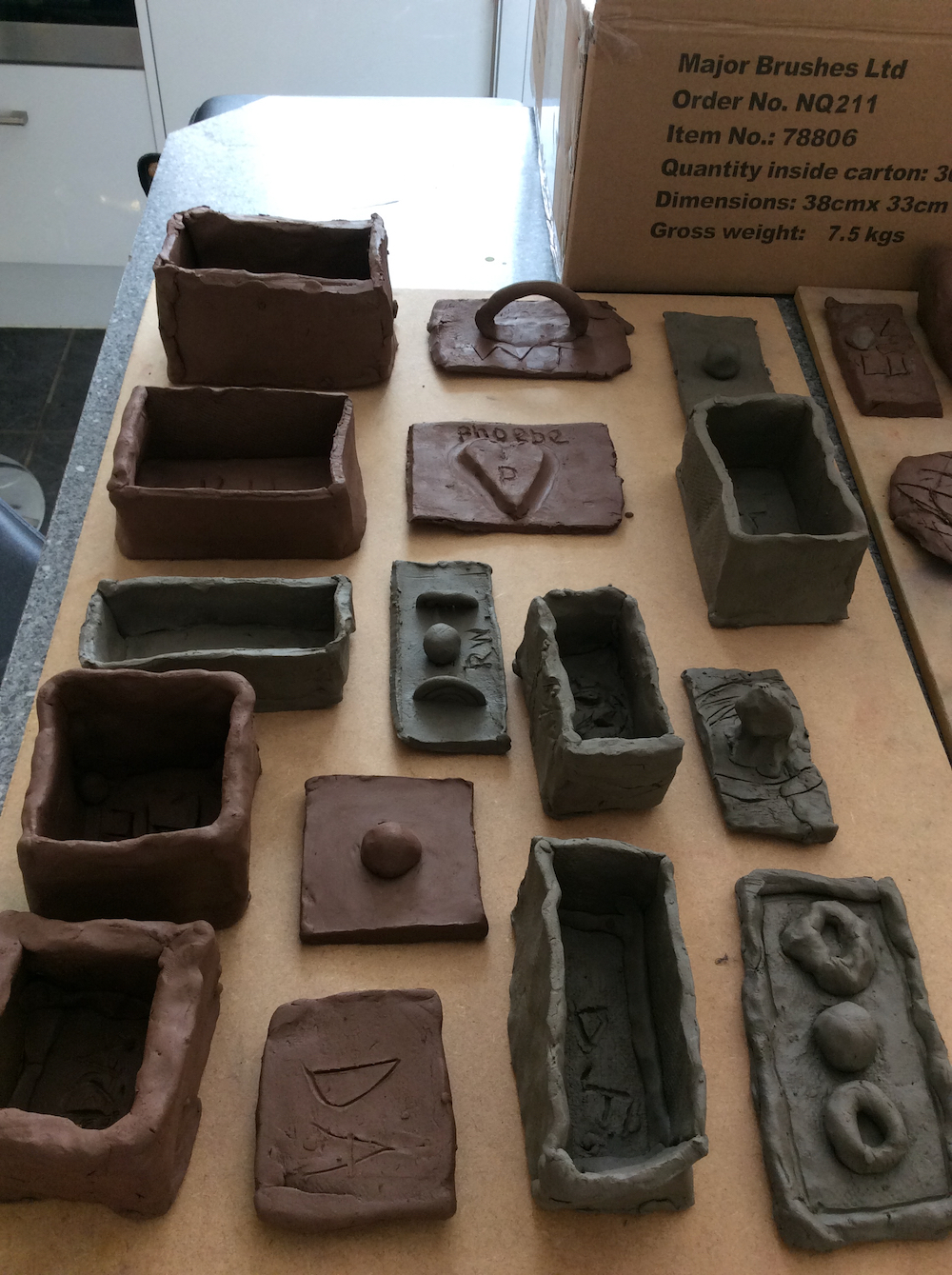 Finished memory boxes made in clay by Year 6 pupils