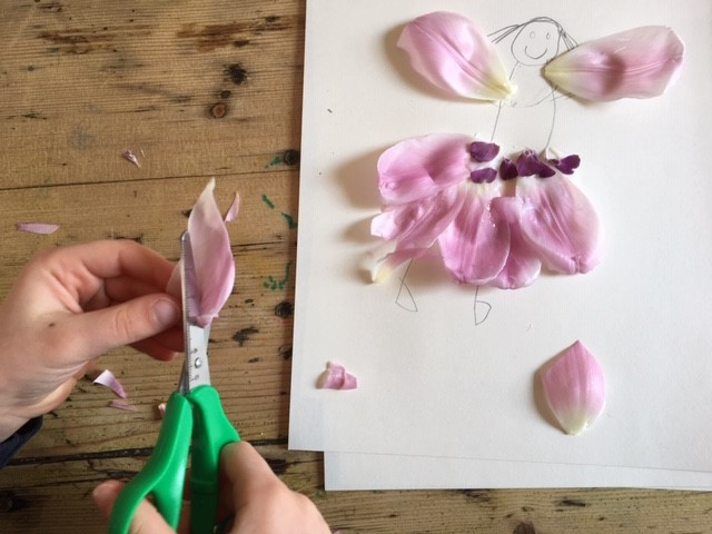 trimming petals with scissors