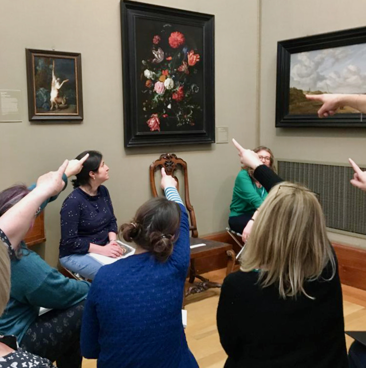 Teachers pointing at flowers in a glass vase by de Heem at the Fitzwilliam Museum, Cambridge