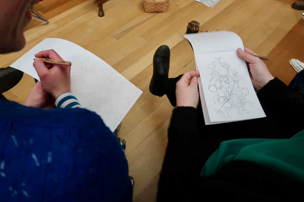 Drawing the shapes between the flowers looking at de Heem's flowers in a glass vase at the Fitzwilliam Museum, Cambridge