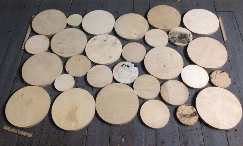 wooden circles ready for sanding and varnishing