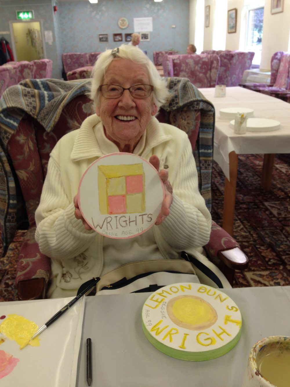 An elderly participant with her design