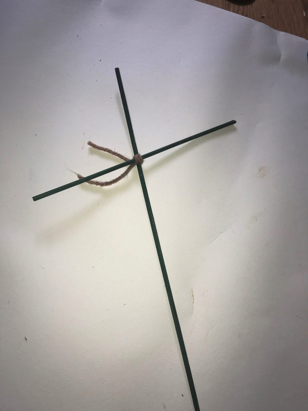 two rods joined in a cross shape