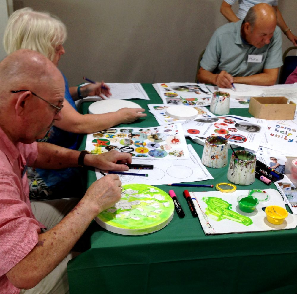 A senior citizen drop in art class