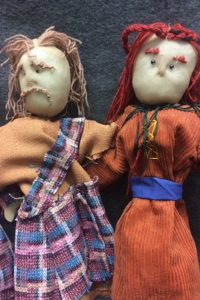 Two puppets showing variation achieved through different costume designs