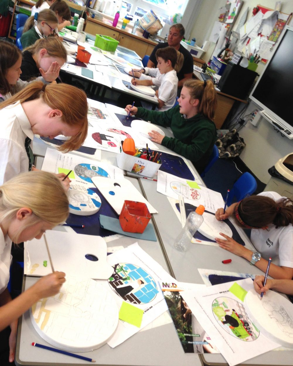 primary school children working on their designs