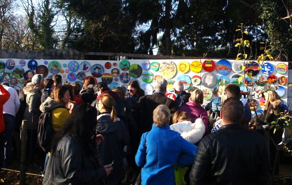 crowds gathered to see the mural unveiled