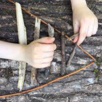 arranging twigs into a triangular formation