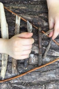 arranging twigs into a triangular formation