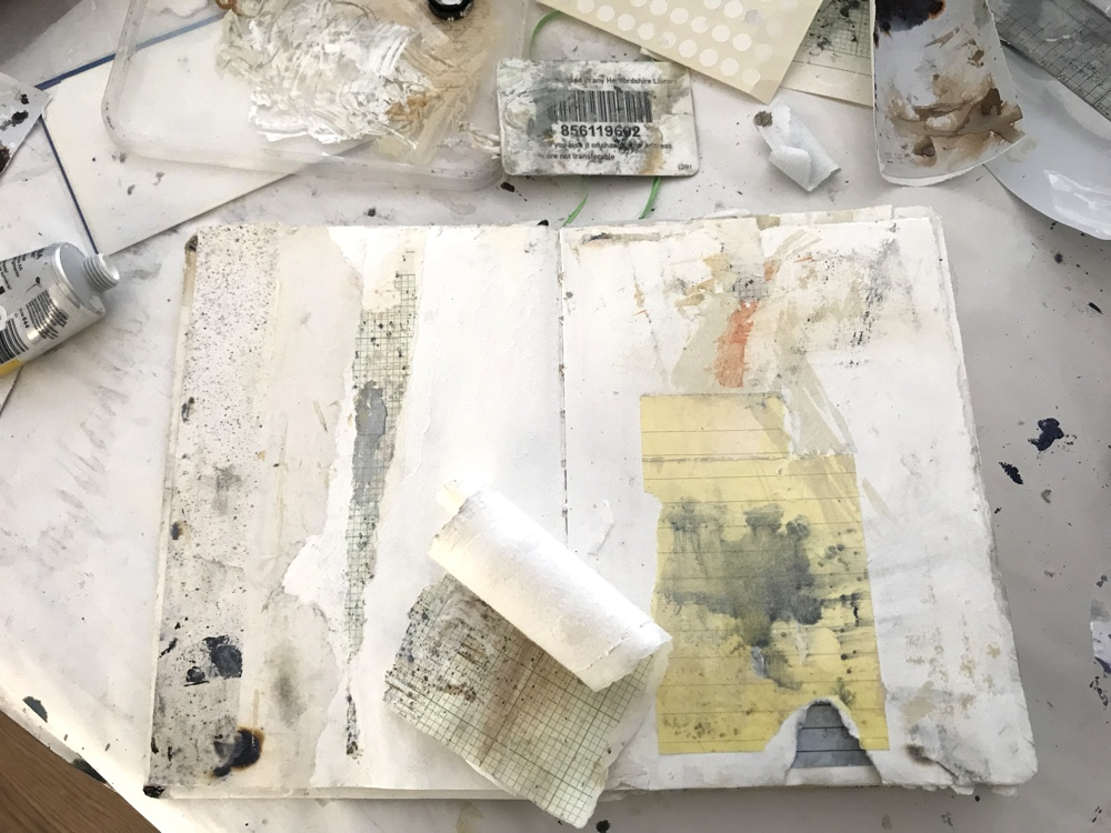 Sketchbook using mark making and collage