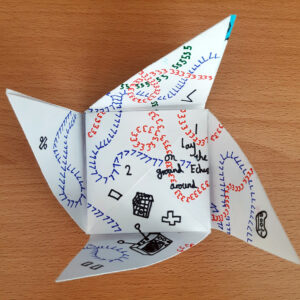 An unfolded origami puzzle purse created by children -by Eilis Hanson