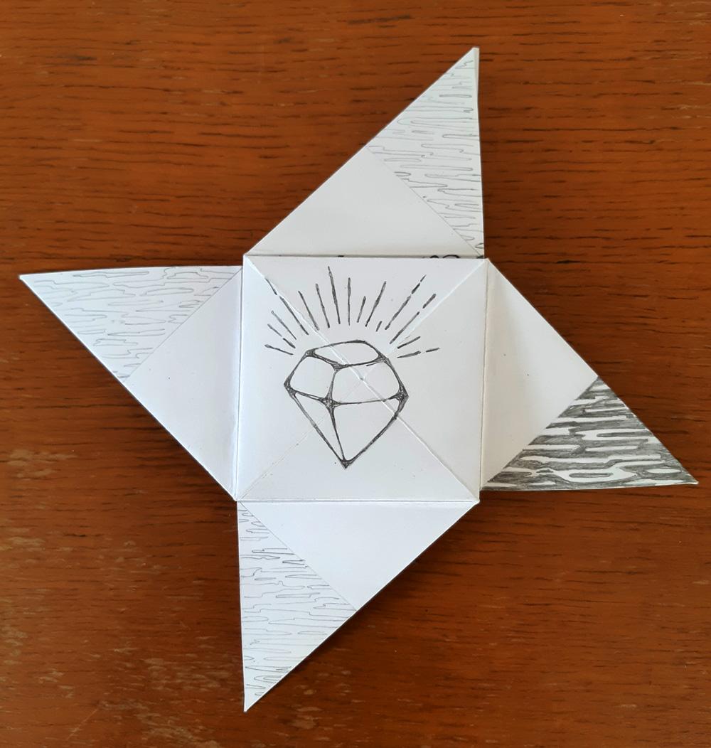 A folded origami puzzle purse by Eilis Hanson
