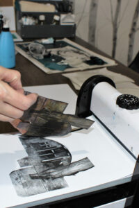 Using a printing press by Karen Wicks
