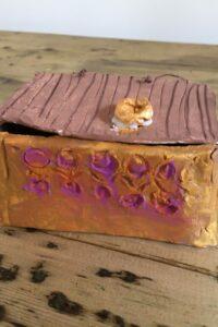 A replica Pandora's box made from clay