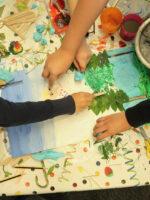 Children participating in a collaborative collage